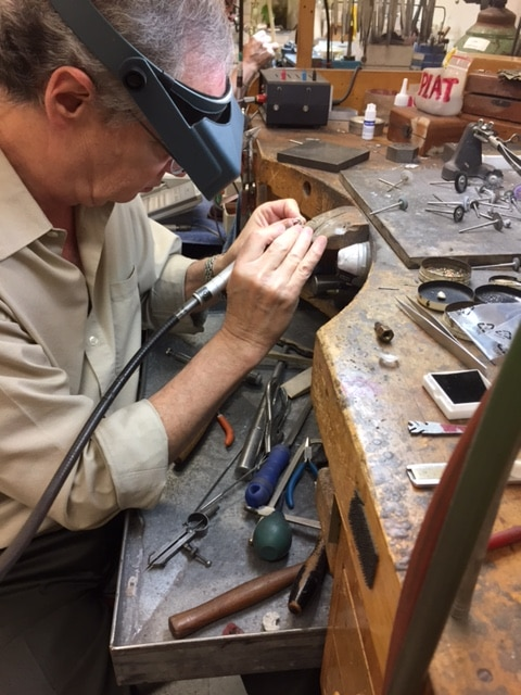 Clay Copeland at his jewelry bench performing jewelry repairs.
