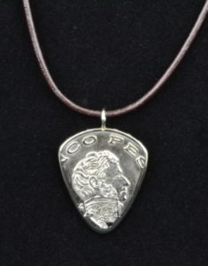 Worn on a cord, as a keychain, or as a zipper pull, a coin guitar pick makes a great unique Father's Day gift!