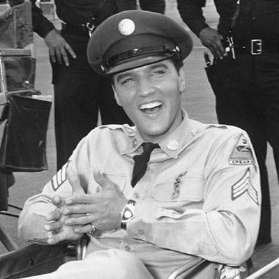 Elvis Presley wearing the Hamilton Ventura fine watch on a movie set.