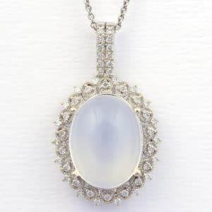 Custom moonstone and diamond pendant from Copeland Jewelers.
