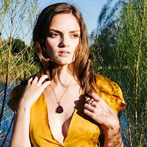 model wearing custom jewelry made by Copeland Jewelers in Austin, Texas.