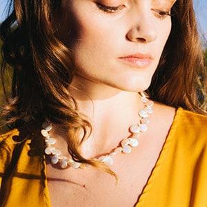 model wearing pearl necklace