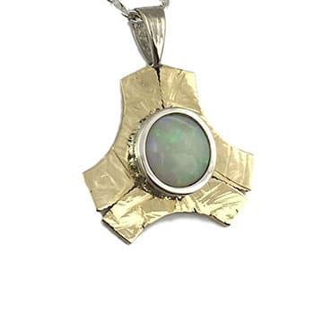 Opal coin frame pendant available only at Copeland Jewelers in Austin, TX