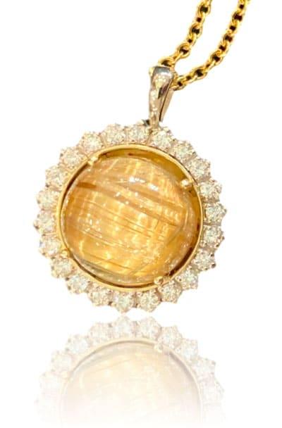 rutilated quartz rolex bezel pendant created by Clay Copeland